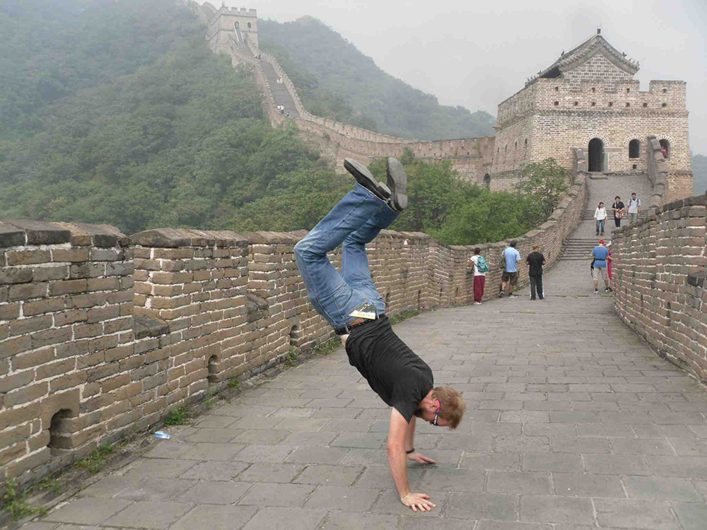 Celebrating the Great Wall with a mediocre/bad handstand.