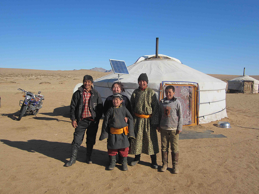 The Shaman (second from the right) with his family in front of their ger the next morning.