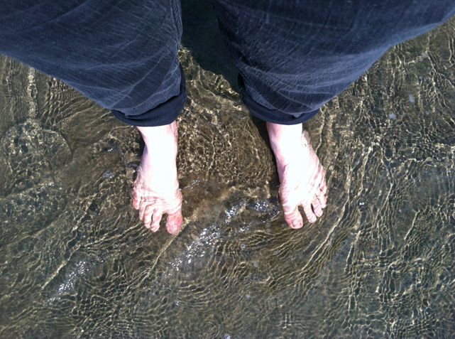 Celebratory toe dip into the Pacific.