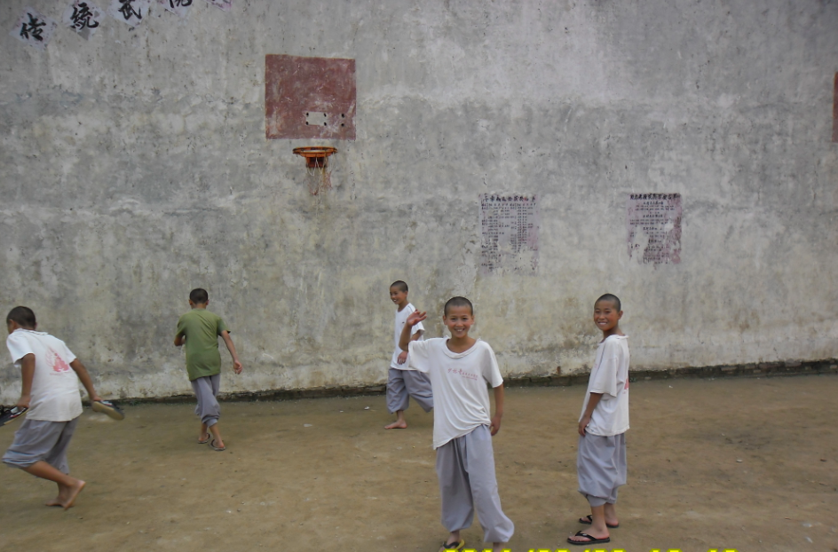 Shaolin kids having fun playing some b-ball.