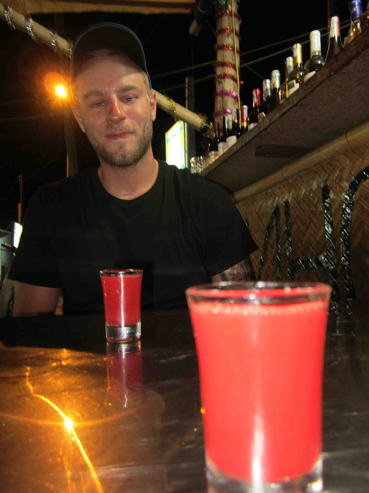 My buddy Mark contemplating our first shots of cobra blood and vodka.