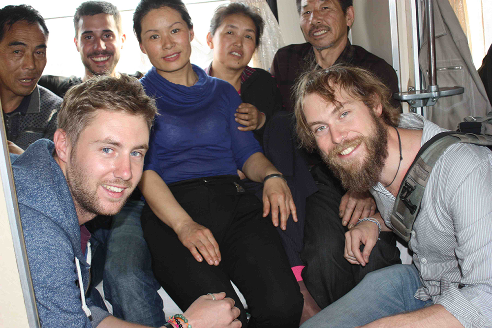 Johnny, Ian, an Uzbek family, and my bearded self.