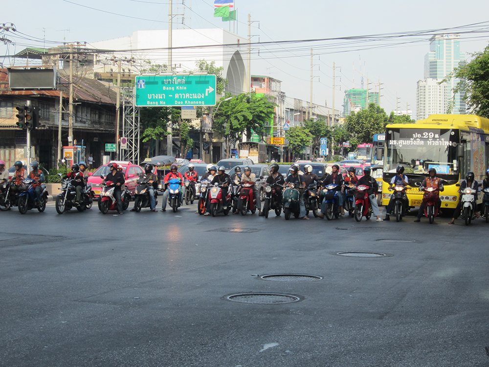 Motorbikes lined up and ready to race into traffic in Bangkok.