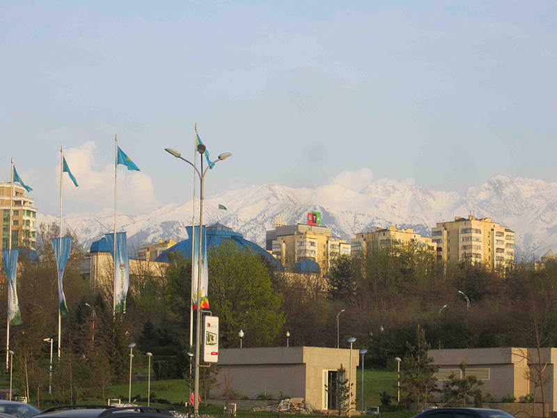 The snowy mountains circling Almaty.
